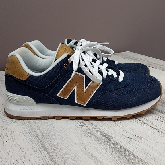 sale retailer a3a37 383cf New Balance 574 denim and leather sneakers.